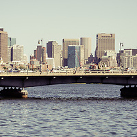 Panorama photo of the Boston skyline with Harvard Bridge and the Boston Back Bay along the Charles River. Panoramic photo ratio is 1:3. Boston Massachusetts is a major city in the Eastern United States of America. Copyright ⓒ Paul Velgos with All Rights Reserved.