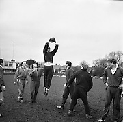 Noel Murphy, left, of Cork, watches Ken Goodall jumping for the ball in a practice line out during Irish team practice in Dublin, Friday 20th January, 1967,..Irish Rugby Football Union, Ireland v Australia, Ireland team pracrtice, Dublin, Ireland, Friday 20th January, 1967,.20.1.1967, 1.20.1967, ..Referee- M Joseph, Welsh Rugby Union, ..Score- Ireland 15 - 8 Australia, ..Irish Team, ..T J Kiernan,  Wearing number 15 Irish jersey, Full Back, Cork Constitution Rugby Football Club, Cork, Ireland,..A T A Duggan, Wearing number 14 Irish jersey, Right Wing, Landsdowne Rugby Football Club, Dublin, Ireland,..F P K Bresnihan, Wearing number 13 Irish jersey, Right Centre, University College Dublin Rugby Football Club, Dublin, Ireland, ..H H Rea, Wearing number 12 Irish jersey, Left Centre, Edinburgh University Rugby Football Club, Edinburgh, Scotland, ..P J McGrath,  Wearing number 11 Irish jersey, Left Wing, University college Cork Rugby Football Club, Cork, Ireland,  ..C M H Gibson, Wearing number 10 Irish jersey, Stand Off, N.I.F.C, Rugby Football Club, Belfast, Northern Ireland, ..B F Sherry, Wearing number 9 Irish jersey, Scrum Half, Terenure Rugby Football Club, Dublin, Ireland, ..K G Goodall, Wearing number 8 Irish jersey, Forward, Newcastle University Rugby Football Club, Newcastle, England, ..M G Doyle, Wearing number 7 Irish jersey, Forward, Edinburgh Wanderers Rugby Football Club, Edinburgh, Scotland, ..N Murphy, Wearing number 6 Irish jersey, Forward, Cork Constitution Rugby Football Club, Cork, Ireland,..M Molloy, Wearing number 5 Irish jersey, Forward, University College Galway Rugby Football Club, Galway, Ireland,  ..W J McBride, Wearing number 4 Irish jersey, Forward, Ballymena Rugby Football Club, Antrim, Northern Ireland,..P O'Callaghan, Wearing number 3 Irish jersey, Forward, Dolphin Rugby Football Club, Cork, Ireland, ..K W Kennedy, Wearing number 2 Irish jersey, Forward, C I Y M S Rugby Football Club, Belfast, Northern Ireland, ..T A Moroney, Wearing numb