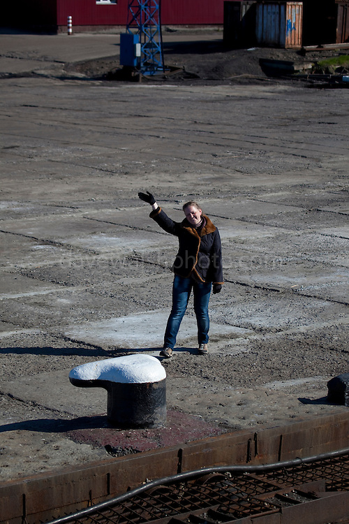 Tourist guide waves goodbye, Barentsburg, a Russian coal mining town in the Norwegian Archipelego of Svalbard. Once home to about 2000 miners and their families, less than 500 people now live here.
