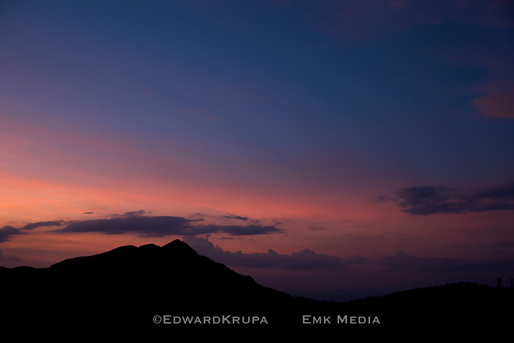 Sunset over mountain ridge in China.