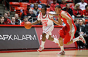 Utah guard Josh Watkins, left, heads down the court as New Mexico guard Kendall Williams, right, defends during an NCAA college basketball game, Wednesday, Jan. 19, 2011, in Salt Lake City. (AP Photo/Colin E Braley)
