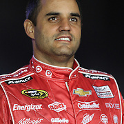 NASCAR Sprint Cup driver Juan Pablo Montoya (42) is seen during the driver introductions prior to the NASCAR Sprint Unlimited Race at Daytona International Speedway on Saturday, February 16, 2013 in Daytona Beach, Florida.  (AP Photo/Alex Menendez)