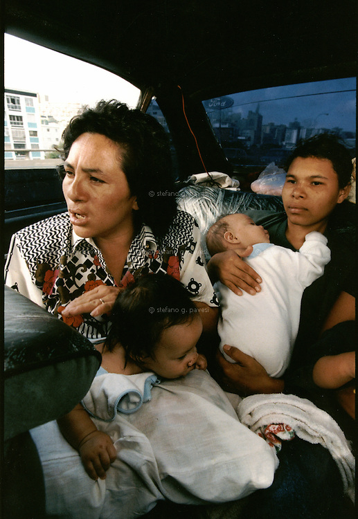 Caracas, Venezuela, 1999. On the way to the hospital on a taxi.<br /> <br /> Operation Smile is a private, not-for-profit volunteer medical services organization providing reconstructive surgery and related health care to indigent children worldwide.
