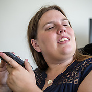 ARLINGTON, VA -JUNE3:  Tiffany Jolliff, who is blind, demonstrates how she formerly used the Uber app on her phone, June 3, 2016, in her apartment in Arlington, VA. The Washington Lawyers' Committee for Civil Rights and Urban Affairs filed a lawsuit Thursday in federal district court in the Eastern District of Virginia on behalf of Tiffany Jolliff against Uber, alleging violations of the Americans With Disabilities Act and the Virginians with Disabilities Act, alleging Uber unlawfully refused to accommodate Jolliff, who is blind, and her service dog, Railey. The complaint alleges that Jolliff, who works as a policy specialist for the federal government on employment for workers with disabilities, has been repeatedly discriminated against and denied Uber's services when Uber's drivers have seen that she is accompanied by her service dog Railey. Specifically, instead of accommodating her service dog Railey, as both the ADA and VDA require, Uber drivers have repeatedly driven off upon seeing that Ms. Jolliff had a service dog. (Photo by Evelyn Hockstein/For The Washington Post)