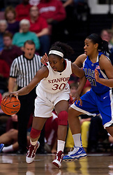 December 15, 2009; Stanford, CA, USA;  Stanford Cardinal forward Nnemkadi Ogwumike (30) is guarded by Duke Blue Devils guard/forward Keturah Jackson (31) during the first half at Maples Pavilion.  Stanford defeated Duke 71-55.