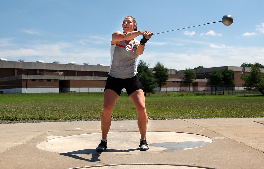 Spt6/23/04 Photo by Mara Lavitt--Anna Mahon turns<br /> ML0138D #3474<br /> Hammer thrower Anna Mahon of Orange practicing at SCSU.