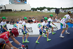 The Orica-AIS Cycling Team climb on the sign-on podium before the 121.5 km road race of the UCI Women's World Tour's 2016 Grand Prix Plouay women's road cycling race on August 27, 2016 in Plouay, France. (Photo by Balint Hamvas/Velofocus)