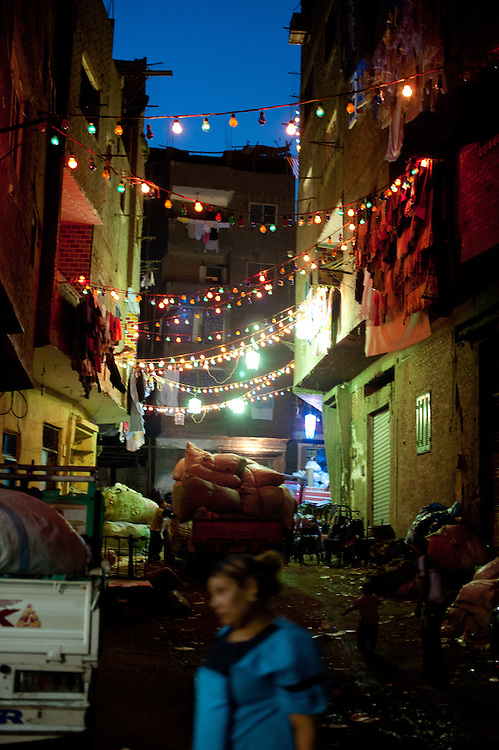 An alleyway in Izbet az-Zabaleen at night.