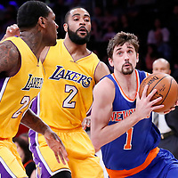 12 March 2015: New York Knicks guard Alexey Shved (1) drives past Los Angeles Lakers guard Wayne Ellington (2) and Los Angeles Lakers forward Tarik Black (28) during the New York Knicks 101-94 victory over the Los Angeles Lakers, at the Staples Center, Los Angeles, California, USA.