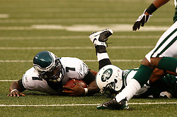 Sept 3, 2009; East Rutherford, NJ, USA;   Philadelphia Eagles quarterback Michael Vick (7) is taken down by New York Jets safety Kerry Rhodes (25) during the first half at Giants Stadium.