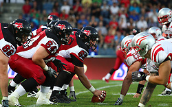 11.07.2011, UPC Arena, Graz, AUT, American Football WM 2011, Group B, Canada (CAN) vs Austria (AUT), im Bild both teams wait for the snap from Dan Bederman (Canada, #62, OL) on the line of scrimmage // during the American Football World Championship 2011 Group B game, Canada vs Austria, at UPC Arena, Graz, 2011-07-11, EXPA Pictures © 2011, PhotoCredit: EXPA/ T. Haumer