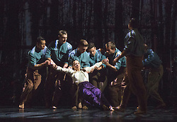 """© Licensed to London News Pictures. 14/01/2015. London, England. Dress rehearsal of """"Young Men"""" by BalletBoyz the Talent. """"Young Men"""" is a brand new work from BalletBoyz which premieres at Sadler's Wells on 14 January 2015 and simulaneously opens Sadler's 2015 programme. """"Young Men"""" is a moving portrayal of love, friendship, losss and survival and explores the theme of war and the bonds that develop between the young men who are utterly consumed by it. Produced by BalletBoyz artistic director Michael Nunn and William Trevitt, choreography by Ivan Perez, newly commissioned score by Keaton Henson which is performed live onstage by a 12-strong band of musicians. Dancers: Andrea Carrucciu, Dalma Doman, Simone Donati, Flavien Esmieu, Marc Galvez, Adam Kirkham, Edward Pearce, Leon Poulton, Matthew Rees, Matthew Sandiford, Bradley Waller and Jennifer White. Photo credit: Bettina Strenske/LNP"""