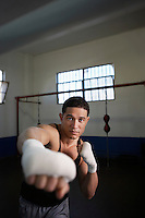 Portrait of man training in gym