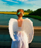 Long Island Angel, dusk at Levy Park, Long Island, New York. <br /> <br /> This image may also be ordered in greeting cards, prints, and canvas.