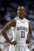 FAYETTEVILLE, AR - NOVEMBER 30:  BJ Young #11 of the Arkansas Razorbacks reacts after a call during a game against the Syracuse Orangemen at Bud Walton Arena on November 30, 2012 in Fayetteville, Arkansas.  The Orangemen defeated the Razorbacks 91-82.  (Photo by Wesley Hitt/Getty Images) *** Local Caption *** BJ Young