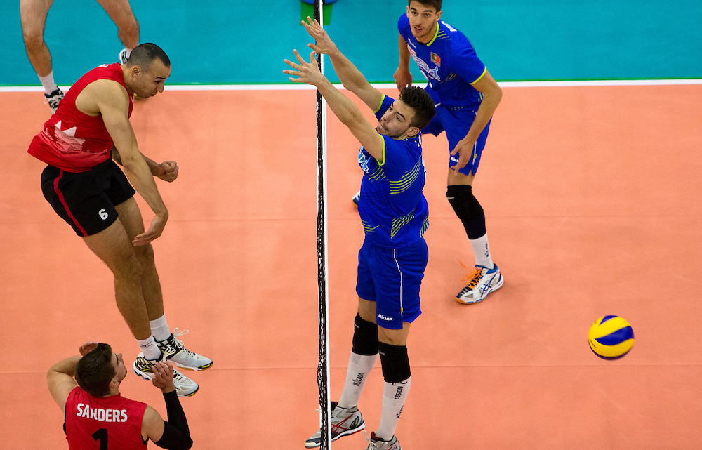 Justin Duff (6) of Canada spikes the ball versus Portugal during a World League Volleyball match at the Sasktel Centre in Saskatoon, Saskatchewan Canada on June 26, 2016.