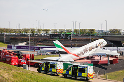 London, UK. 19th April, 2019. Police vehicles alongside the main motorway approach to Heathrow airport following a small protest earlier by Extinction Rebellion Youth. A large police presence is evident around the airport but so far any disruption feared by the airport authorities from Extinction Rebellion climate change activists has been symbolic rather than material. Credit: Mark Kerrison/Alamy Live News
