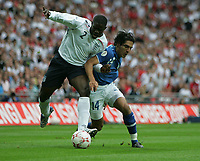 Photo: Lee Earle.<br /> England v Israel. UEFA European Championships Qualifying. 08/09/2007.England's Micah Richards (L) battles with Yoav Ziv.