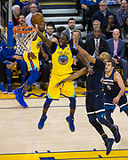 Golden State Warriors forward Draymond Green (23) takes the ball to the basket against the Minnesota Timberwolves at Oracle Arena in Oakland, Calif., on January 25, 2018. (Stan Olszewski/Special to S.F. Examiner)