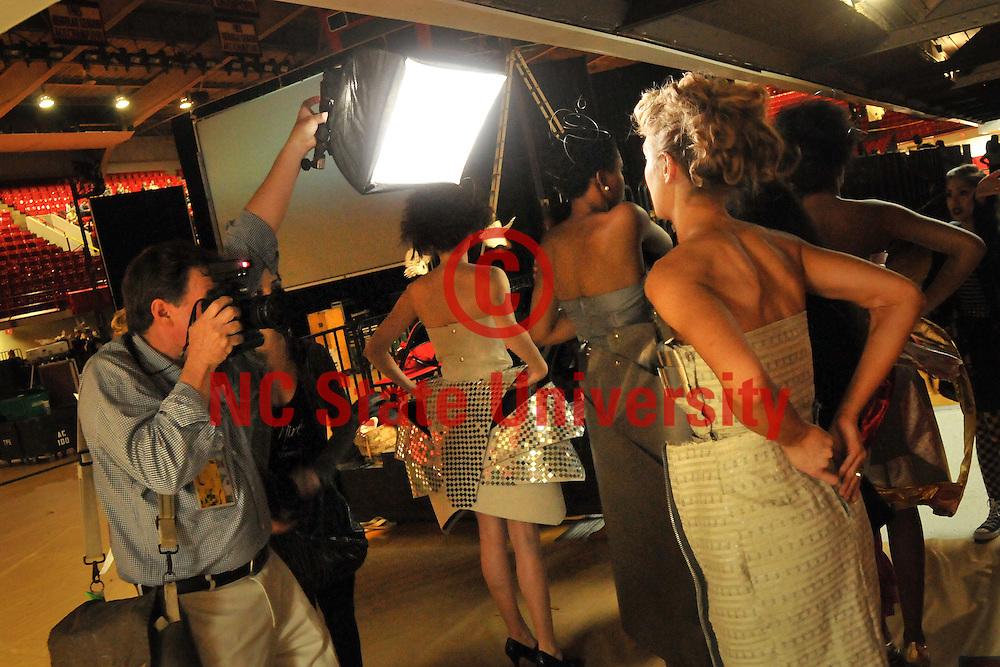 News & Observer photographer Robert Willett (left) photographs a model backstage.