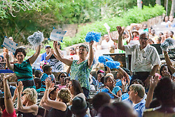 "Ulla Muller supporters cheer for their students.  Dancing Classrooms Virgin Islands students compete in ""Colors of the Rainbow"" team match competition at Reichhold Center for the Arts.  St. Thomas, USVI.  9 May 2015.  © Aisha-Zakiya Boyd"