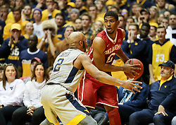 Jan 6, 2018; Morgantown, WV, USA; Oklahoma Sooners guard Kameron McGusty (20) holds the ball while guarded by West Virginia Mountaineers guard Jevon Carter (2) during the first half at WVU Coliseum. Mandatory Credit: Ben Queen-USA TODAY Sports
