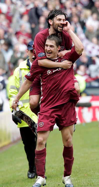 Paul Hartley and Rudi Skacel celebrate Hearts 4-0 win over Hibs. Photo: Tom Ross.<br />Hibernian v Hearts. Tennants Scottish Cup, Semi-Final. 02/04/2006.