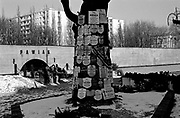A dead tree with hundreds of obituaries pinned to it near the remnants of the Pawiak prison, Warsaw. After the 1944 Uprising the tree served as a notice board for people searching for their relatives.