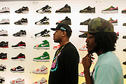 "Rap producer Mike WiLL Made It with producer Marquel ""Marz"" Middlebrooks checks out and buys new Air Jordan's at Athlete's Foot in Cumberland Mall in Atlanta, Georgia, October 4, 2012."