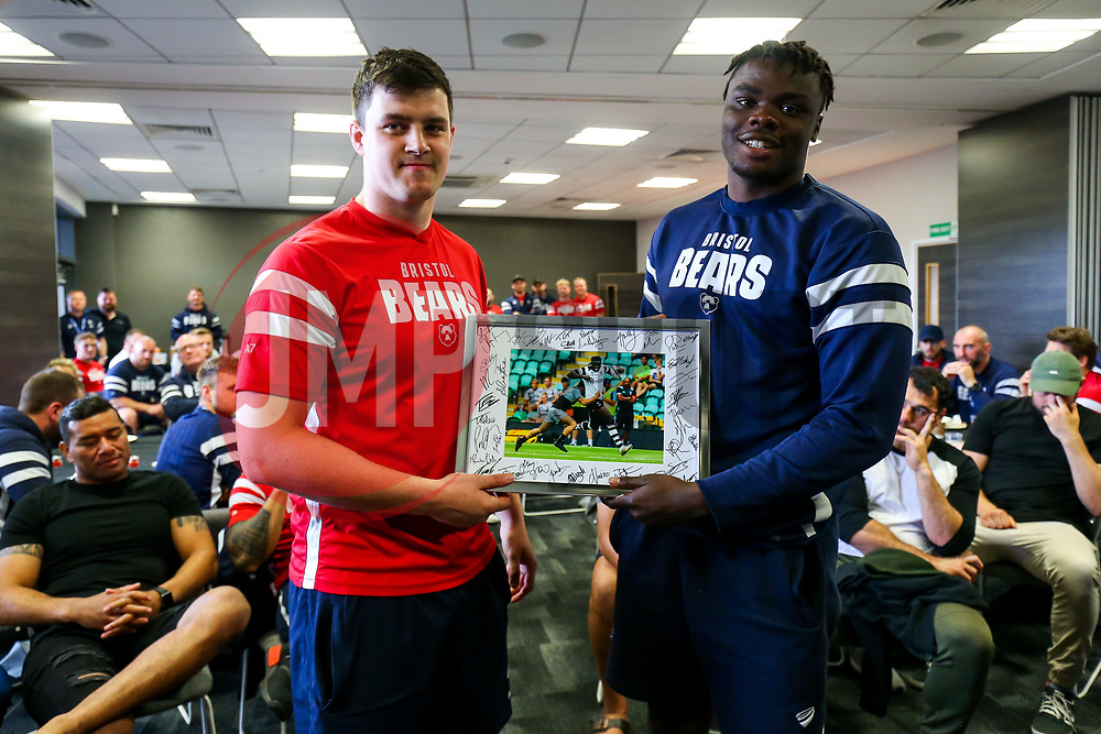 John Hawkins thanks Ehize Ehizode as the Bristol Bears squad gather to make presentations to departing players after the Bristol Bears Team Run ahead of the Sale Sharks Game - Rogan/JMP - 02/05/2019 - RUGBY UNION - Ashton Gate Stadium - Bristol, England - Bristol Bears v Sale Sharks - Gallagher Premiership Rugby.