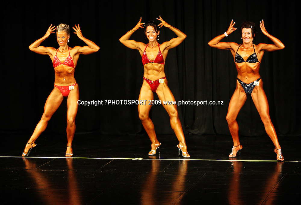 Novice Figure - Short competitors (from left): Andrea Keene, Andrea Berry and Sheryl Ferguson.<br /> NZFBB Bodybuilding Championships at Memorial Theatre, Victoria University, Wellington. Saturday, 19 September 2009. Photo: Dave Lintott/PHOTOSPORT