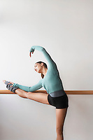 Ballet Dancer bending at bar