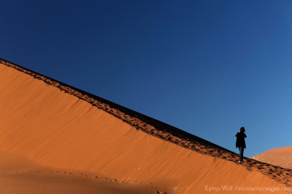 Africa, Namibia, Sossusvlei. Person on dune in the Namib Desert of Sossusvlei.
