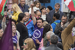 March 23, 2019 - Madrid, Spain - A Podemos militant seen raising his fist during the rally..Hundreds of people gathered at the rally of Podemos ''He returns'' (Vuelve in Spanish) as an act of pre-election campaign after the return of the party leader, Pablo Iglesias. During the rally, different members of the Unidos Podemos group participated. (Credit Image: © Lito Lizana/SOPA Images via ZUMA Wire)