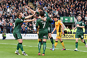 Graham Carey (10) of Plymouth Argyle celebrates scores a goal to give a 3-0 lead to the home team with Antoni Sarcevic (7) of Plymouth Argyle and David Fox (24) of Plymouth Argyle during the EFL Sky Bet League 2 match between Plymouth Argyle and Newport County at Home Park, Plymouth, England on 17 April 2017. Photo by Graham Hunt.