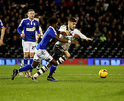 Fulham defender Luke Garbutt battling with Ipswich midfielder Ainsley Maitland-Niles during the Sky Bet Championship match between Fulham and Ipswich Town at Craven Cottage, London, England on 15 December 2015. Photo by Matthew Redman.