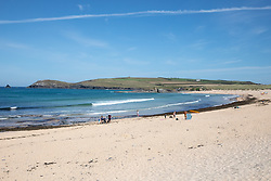 © Licensed to London News Pictures. 29/05/2020. Padstow, UK. General view of Constantine beach on the north coast of Cornwall this morning, as RNLI Lifeguards resume service on as one of a select few beaches. Up until today, the RNLI have not been providing a lifeguard service in Cornwall, due to Coronavirus (COVID-19). The weather in the south-west is forecast to be warm over the weekend, with highs of 23 degrees Celsius. Photo credit : Tom Nicholson/LNP