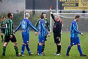 Nederland, Haps, 18-11-2013Een scheidsrechter van een voetbalwedstrijd bij de amateurs geeft een rode kaart aan een speler wegens ruw spal.Foto: Flip Franssen/Hollandse Hoogte