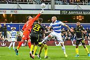 Queens Park Rangers defender Toni Leistner (37) in a challenge with Brentford defender Julian Jeanvier (23) and Brentford goalkeeper David Raya Martin (1) during the EFL Sky Bet Championship match between Queens Park Rangers and Brentford at the Kiyan Prince Foundation Stadium, London, England on 28 October 2019.