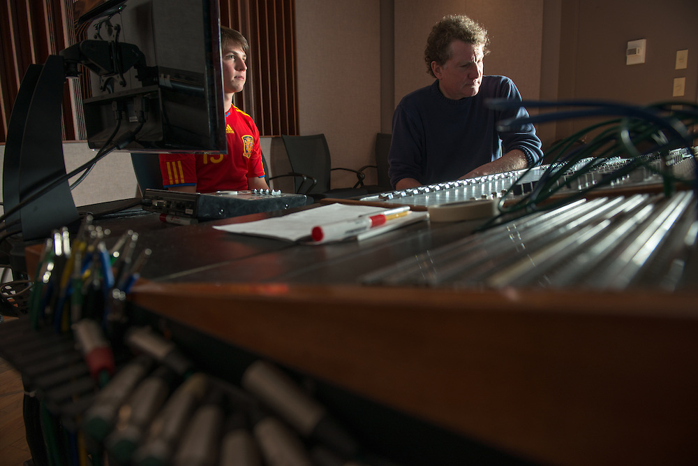 Student Leo Sideras (Left) assists Eddie Ashworth in a recording session at MDIA Sound.