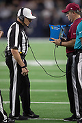 NFL referee Walt Anderson (66) reviews and confirms the call on the field after Dallas Cowboys cornerback Jourdan Lewis (27) intercepts a late fourth quarter pass and runs it back 7 yards to the New Orleans Saints 16 yard line on the game winning turnover as the time clocks winds down during the NFL week 13 regular season football game against the New Orleans Saints on Thursday, Nov. 29, 2018 in Arlington, Tex. The Cowboys won the game 13-10. (©Paul Anthony Spinelli)
