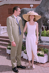 MR BEN COLLINGS and LADY LOUISA GORDON LENNOX daughter of the Duke of Richmond, at a race meeting in Sussex on 30th July 1997.MAS 72