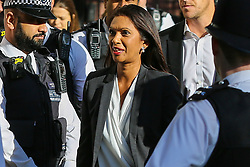 © Licensed to London News Pictures. 19/09/2019. London, UK. Businesswoman and political activist GINA MILLER surrounded by police officers arrives at UK Supreme Court in London  on the final day of the three day appeal hearing in the multiple legal challenges against the Prime Minister Boris Johnson's decision to prorogue Parliament ahead of a Queen's speech on 14 October. Since Tuesday 17 September, eleven instead of the usual nine Supreme Court justices have been hearing the politically charged claim that Boris Johnson acted unlawfully in advising the Queen to suspend parliament for five weeks in order to stifle debate over the Brexit crisis. It is the first time the Supreme Court has been summoned for an emergency hearing outside legal term time. Lady Hale, the first female president of the court who retires next January, has been preside the Brexit-related judicial review cases. Photo credit: Dinendra Haria/LNP