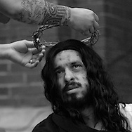 Actors at St. Jerome Catholic Parish in Chicago's Rogers Park neighborhood prepare to reenact the 14 Stages of the Cross, portraying the biblical account of Jesus Christ being condemned to death, followed by his crucifixion and entombment. Portraying Christ is 27 year old Juan Ponce.