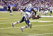 New York Jets cornerback Darrelle Revis (24) intercepts a third quarter pass intended for leaping Indianapolis Colts rookie wide receiver Phillip Dorsett (15) during the 2015 NFL week 2 regular season football game against the Indianapolis Colts on Monday, Sept. 21, 2015 in Indianapolis. The Jets won the game 20-7. (©Paul Anthony Spinelli)