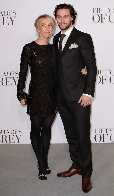 Feb 12, 2015 - 'Fifty Shades of Grey' UK Premiere - Red Carpet Arrivals at Odeon, Leicester Square<br /> <br /> Pictured: Director Sam Taylor-Johnson (L) and Aaron Taylor-Johnson<br /> ©Exclusivepix Media