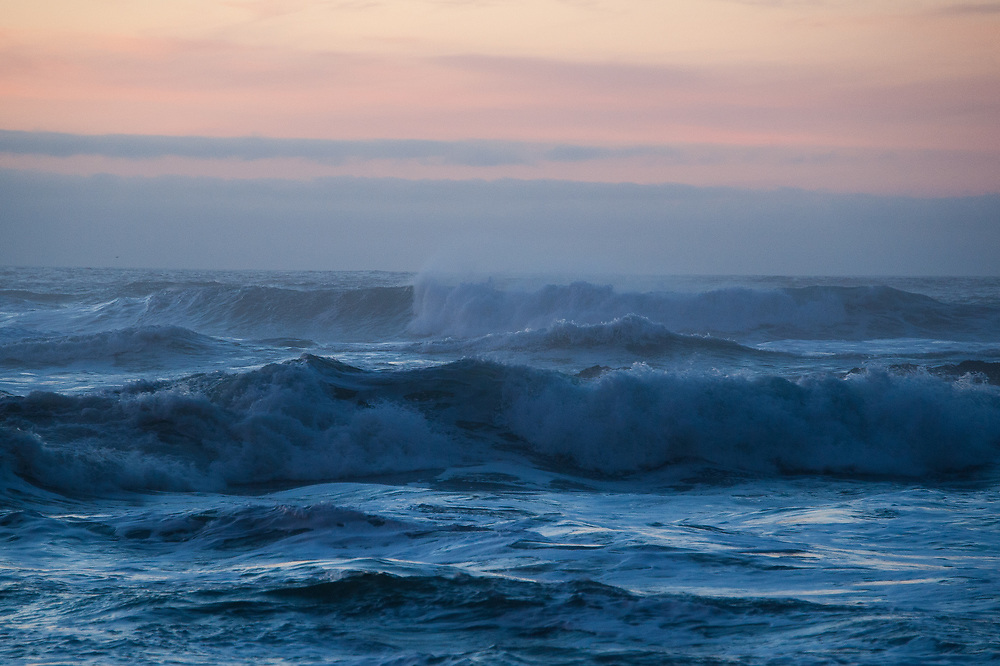 Crashing waves at sunset on Oceanside Beach in Oregon