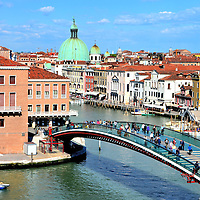 Ponte della Costituzione at Piazzale Roma in Venice, Italy <br /> Cars are not allowed in Venice.  So, once you drive 2.5 miles across the lagoon on the Deck della Libert&agrave;, also called the Freedom Bridge, you&rsquo;ll park in one of the expensive garages at Piazzale Roma.  While stretching your legs, enjoy this first view of the City of Bridges from across the Ponte della Costituzione.  The Constitution Bridge was built in 2008, making it the fourth and newest to span the Grand Canal.
