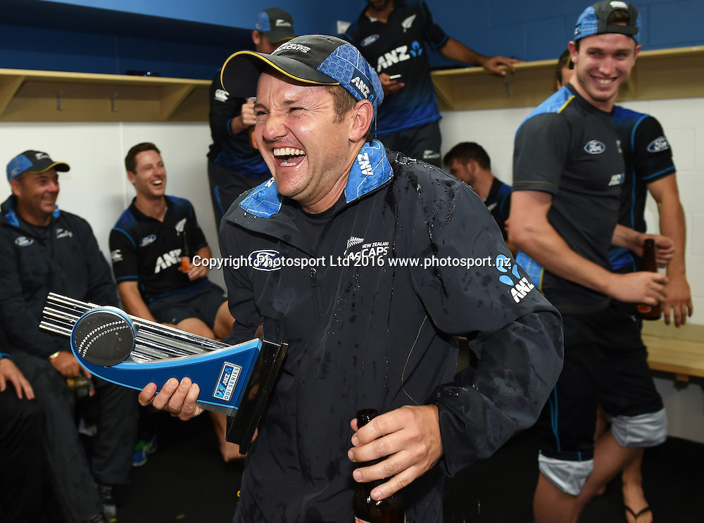 Coach Mike Hesson reacts after having beer poured over him by Adam Milne. New Zealand Black Caps v Australia, Chappell Hadlee Trophy Match 3. ANZ ODI Cricket Series. Seddon Park, Hamilton, New Zealand. Monday 8 February 2016. Copyright photo: Andrew Cornaga / www.photosport.nz