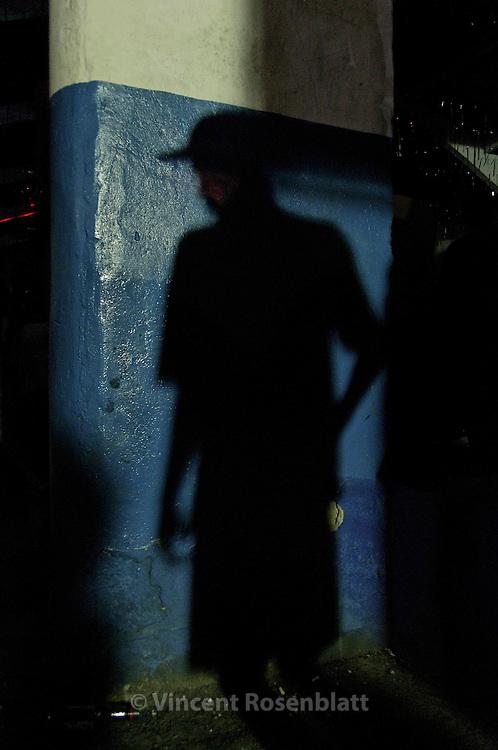 """Shadow of a young """"funkeiro"""", during a Baile at Samba school Vizinha Faladeira, Rio de Janeiro 2008. ."""